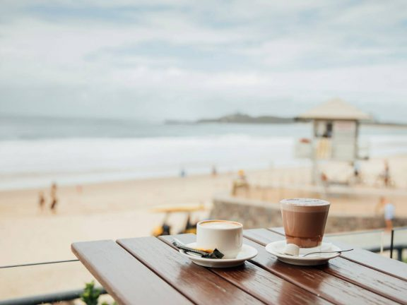 mooloolaba-surf-club-coffee-on-deck-with-view-of-beach