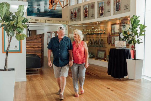 mooloolaba-surf-club-couple-walking-through-reception