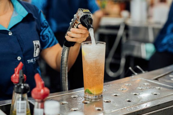 mooloolaba-surf-club-filling-glass-with-soft-drink