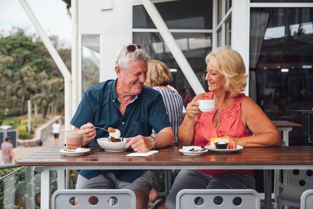 mooloolaba-surf-club-elderly-couple-enjoying-coffee