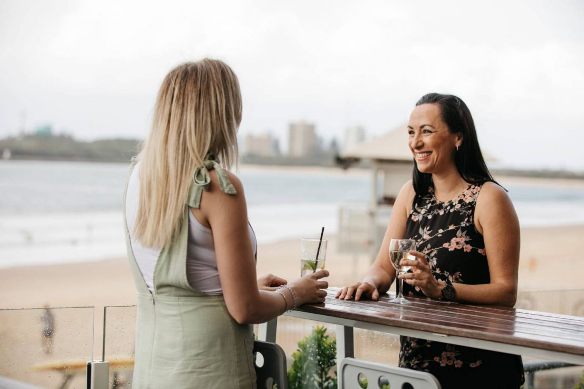 mooloolaba-surf-club-two-women-enjoying-wine-on-deck