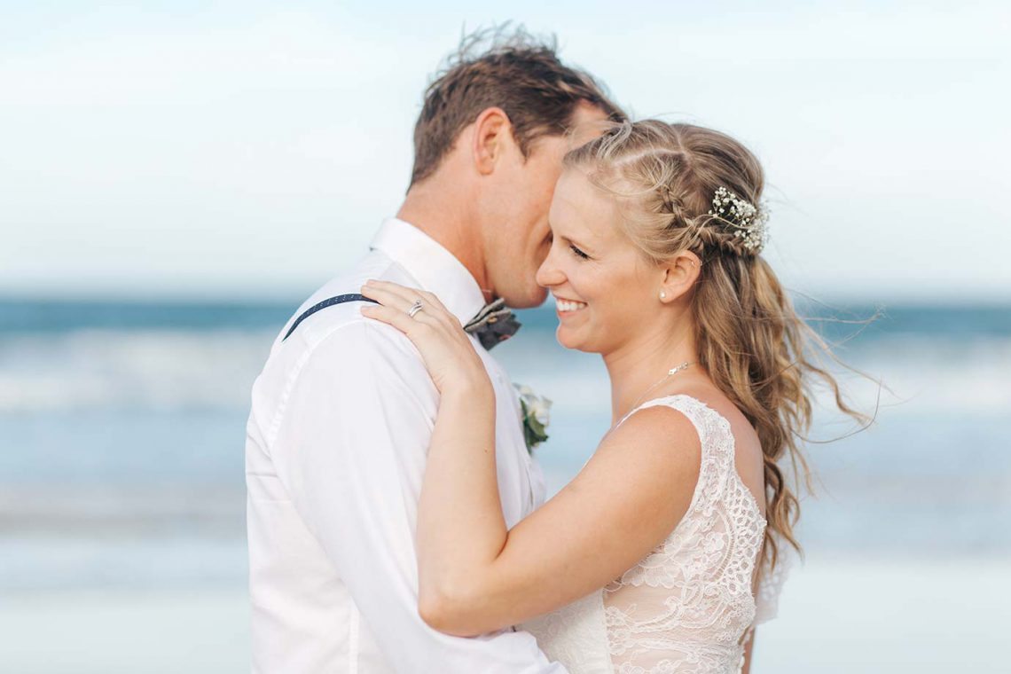 mooloolaba-surf-club-wedding-bride-and-groom-on-beach